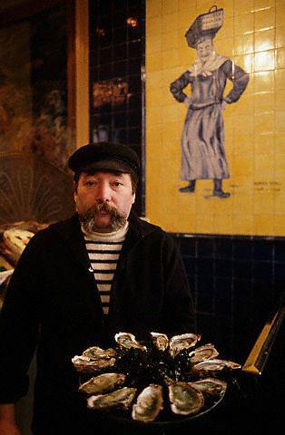 French Oysterman in Paris Restaurant --- Image by © Owen Franken