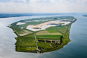 "Nederland, Zuid-Holland, Tiengemeten 10-06-2015; oostelijk deel van het eiland Tiengemeten met zorgboerderij en camping.<br /> Oorspronkelijk gebruikt voor de akkerbouw maar inmiddels 'teruggegeven aan de natuur', de dijken zijn deels doorgestoken, de laatste boer is in 2006 vertrokken. De 'nieuwe natuur' vormt onderdeel van de Ecologische Hoofdstructuur. <br /> The island Tiengemeten in the Haringvliet, was originally used for agriculture but has now ""been given back to nature"". Large parts have been flooded and the isle is part of the National Ecological Network. The last farmer left in 2006. Current use, among other, care farms and camping.<br /> luchtfoto (toeslag op standard tarieven);<br /> aerial photo (additional fee required);<br /> copyright foto/photo Siebe Swart"