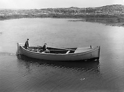 """14-15/ 05/ 1959<br /> 05/14-15/1959<br /> 14-15 May 1959<br /> Sean Mac Donnchadha and his son Seosamh come back from an early morning trip in their Gael Linn boat """"MacDara"""" at Thiar Quay, Carna, Co. Galway."""