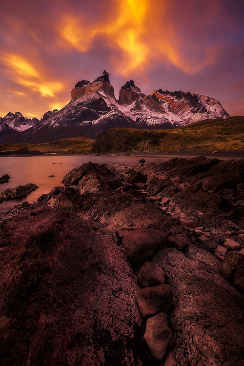 Dramatic clouds hanging over Los Cuernos at sunset in Torres del Paine, Chile