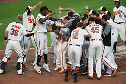 August 23, 2017 - Baltimore, MD, USA - The Baltimore Orioles' Manny Machado, center, is doused with water by teammates at home plate after his walk-off home run in the 12th inning against the Oakland Athletics at Oriole Park at Camden Yards in Baltimore on Wednesday, Aug. 23, 2017. The Orioles won, 8-7, in 12 innings. (Credit Image: © Kenneth K. Lam/TNS via ZUMA Wire)