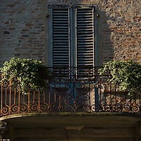Balcony with plants on apartment building, Cherasco, Piedmont
