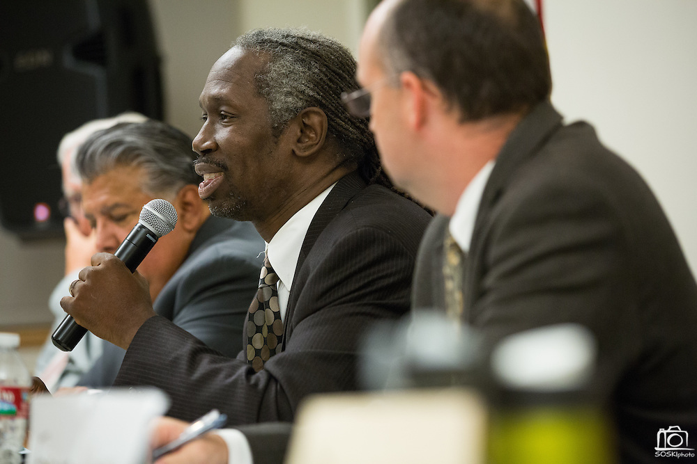 Milpitas native, Chris Norwood, talks about parent involvement with schools during the Milpitas Unified School District Board of Education forum at the Barbara Lee Senior Center in Milpitas, California, on October 2, 2014. (Stan Olszewski/SOSKIphoto)