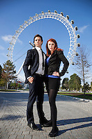 Portrait of confident young business couple standing together against London Eye, London, UK