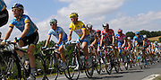 France - Tuesday, Jul 08 2008:  Columbia's Mark Cavendish (on left) rides in the peloton in front of Gerolsteiner's Stefan Schumacher (in the yellow jersey) during the 232km Stage 5 from Cholet to Châteauroux.  Cavendish would go on to win the sprint finish to earn his first win in the Tour de France. (Photo by Peter Horrell / http://www.peterhorrell.com)