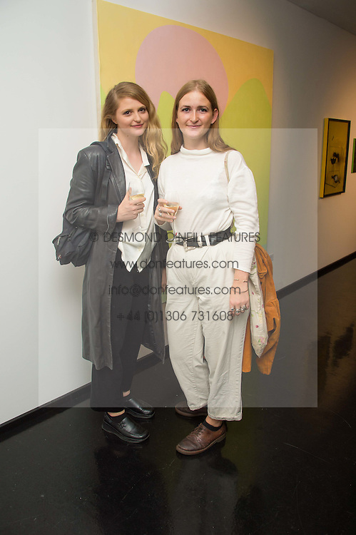 Left to right, ELLE CLARK and CLAUDIA COLE at the Hix Award 2016 held at Unit London, 147 Wardour Street, Soho, London on 5th September 2016.