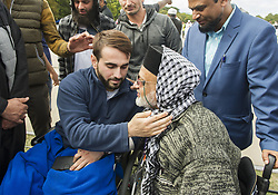 March 22, 2019 - Christchurch, Canterbury, New Zealand - Mustafa Boztas, 21, and Farid Ahmed (right) hug at the Call to Prayer service in Hagley Park, across the street from the Al Noor mosque. Ahmed, a paraplegic, lost his wife Husna Ahmed in the Al Noor shooting. Boztas was shot in the leg as he fled. (Credit Image: © PJ Heller/ZUMA Wire)