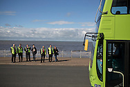 Bus drivers watching one of the competitors taking part in the Bus Driver of the Year competition in Blackpool. The event, first staged in 1967, attracted 105 entrants from across the United Kingdom who completed theory and practical driving test to determine who would win the 2013 award.