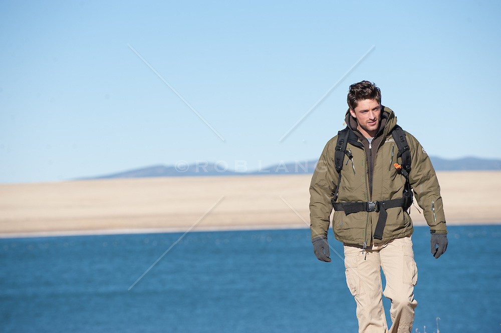 man hiking near a lake in New Mexico