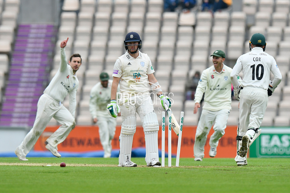 Wicket - Liam Dawson of Hampshire turns to walk back to the pavilion after being bowled by Daryl Mitchell of Worcestershire who celebrates taking the wicke during the Specsavers County Champ Div 1 match between Hampshire County Cricket Club and Worcestershire County Cricket Club at the Ageas Bowl, Southampton, United Kingdom on 13 April 2018. Picture by Graham Hunt.