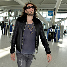 APR 09 2014  Russell Brand departs Heathrow Airport for the US