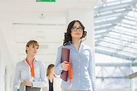 Businesswomen walking at office