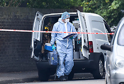 © Licensed to London News Pictures. 25/08/2019. SOUTHALL, UK.  A forensics officer at the scene adjacent to St Mary's Avenue near Southall in west London.  It is reported that a man in his 60s was stabbed outside The Plough pub on Tentelow Avenue in the early evening of 24 August and stumbled to nearby St Mary's Avenue to seek aid from a residence.  Police were called at 6.41pm, paramedics and air ambulance crews attended but the man passed away.  A man in his 30s has been arrested on suspicion of murder.  The investigation continues. Photo credit: Stephen Chung/LNP