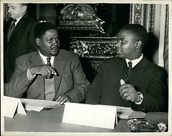 Dec. 12, 1960 - Rhodesia and Nyasaland constititional Review Conference Opens. The African leader - Dr. NKOMO - KENNETH KAUNDA and Dr. HASTING BANDE were among the delegates at todays opening of the Constitutional review conference on Rhodesia and Nyasaland - at Lancaster House. Photo Shows: Mr. JOSHUA NKOMO ( left ) talking to an N.D.P. Representative - Mr. N. SITHLA - at opening of the Conference this morning. they are from Southern Rhodesia. (Credit Image: © Keystone Press Agency/Keystone USA via ZUMAPRESS.com)