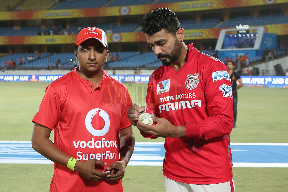 The Vodafone Super Fan looks on as Kings XI Punjab captain Murali Vijay signs the match ball during match 28 of the Vivo IPL 2016 (Indian Premier League) between the Gujarat Lions and the Kings XI Punjab held at Saurashtra Cricket Association Stadium, Rajkot, India on the 1st May 2016<br /> <br /> Photo by Shaun Roy / IPL/ SPORTZPICS