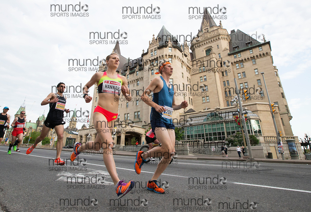 (Ottawa, Canada---24 May 2015) Rachel Hannah runs past the Chateau Laurier at the start of the marathon during the Tamarack Run Ottawa Race Weekend.