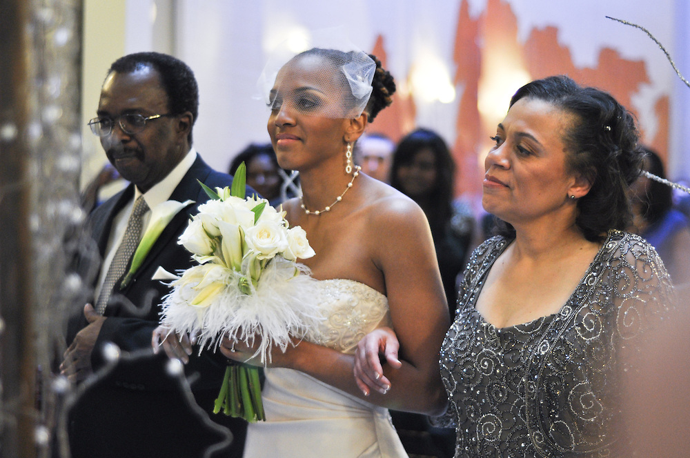 Uzoezi is escorted down the aisle by her mother and father, Merchant's Exchange, San Francisco