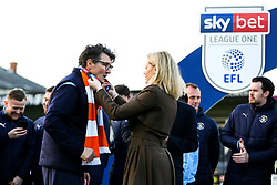 Luton Town manager Mick Harford is presented with a winners medal as Luton Town celebrate winning the league and securing automatic promotion from Sky Bet League 1 to the Sky Bet Championship - Rogan/JMP - 04/05/2019 - Kenilworth Road - Luton, England - Luton Town v Oxford United - Sky Bet League One.