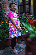 Usha (name changed), aged 10, poses for a portrait outside her house in SOS Children's Villages Sanothimi, Bhaktapur, Nepal on 2 July 2015.  Usha's entire family perished when her house collapsed in the earthquake on 25th April 2015. Usha is now well integrated into her new family and school. Photo by Suzanne Lee for SOS Children's Villages