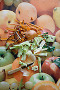 vegetable scrapings laying on a fruit print plastic tablecloth