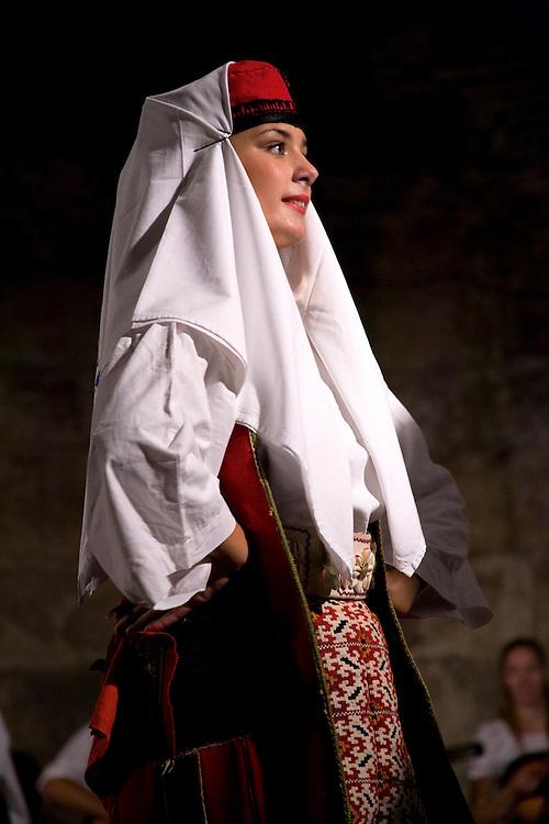 Europe, Croatia, Dalmatia, Split.  Female folk dancer performing in Diocletian's Palace.NMR
