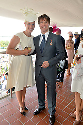 ZARA TINDALL and TOM CRUISE at the 2014 Glorious Goodwood Racing Festival at Goodwood racecourse, West Sussex on 31st July 2014.