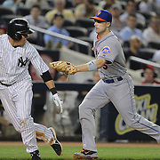 Kelly Johnson, New York Yankees, is tagged on a run down by David Wright, New York Mets, in the sixth inning during the New York Yankees V New York Mets, Subway Series game at Yankee Stadium, The Bronx, New York. 12th May 2014. Photo Tim Clayton