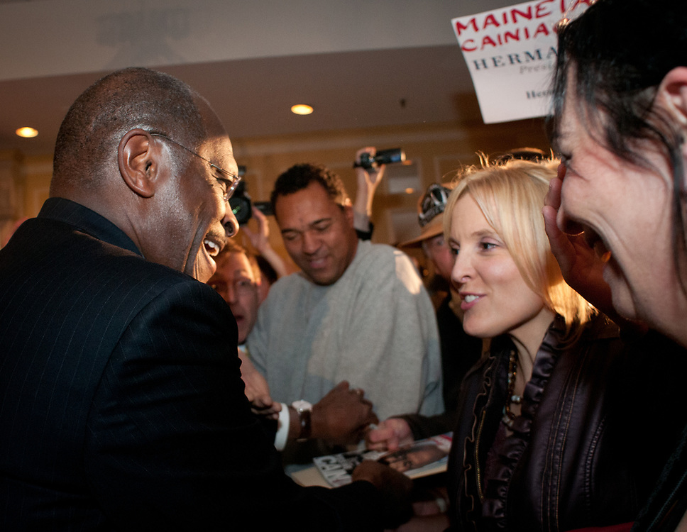Presidential hopeful Herman Cain greets supporters after speaking at a  campaign Rally in the Radisson Hotel in Nashua, NH.