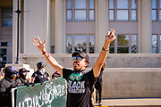 28 JULY 2020 - DES MOINES, IOWA: MATTHEW BRUCE, a Black Lives Matter coordinator, talks to BLM supporters before a march in Des Moines. About 150 supporters of Black Lives Matter marched from downtown to Des Moines to the Governor's Mansion. They were demanding that Iowa Governor Kim Reynolds restore the voting rights for felons who have completed their sentence. In June, Reynolds met with representatives of Black Lives Matter and promised to sign an executive order to restore voting rights, but she hasn't said anything more about it in six weeks. Iowa is now the only state in the US that permanently strips felons of their voting rights. That means 60,000 people in Iowa can't vote.     PHOTO BY JACK KURTZ