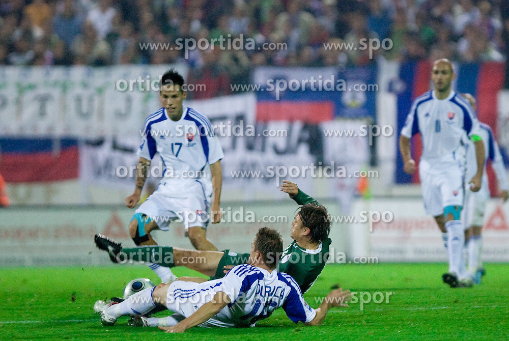 Zlatko Dedic of Slovenia between Marek Hamsik and Jan Durica of Slovakia at  the FIFA World Cup Qualifications match between Slovakia and Slovenia, on October 10, 2009, Tehelne Pole Stadium, Bratislava, Slovakia.  (Photo by Vid Ponikvar / Sportida)