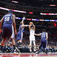 12 April 2016: Los Angeles Clippers guard Chris Paul (3) takes a jump shot over Memphis Grizzlies forward Chris Andersen (7) and Memphis Grizzlies forward Matt Barnes (22) during the Los Angeles Clippers 110-84 victory over the Memphis Grizzlies, at the Staples Center, Los Angeles, California, USA.