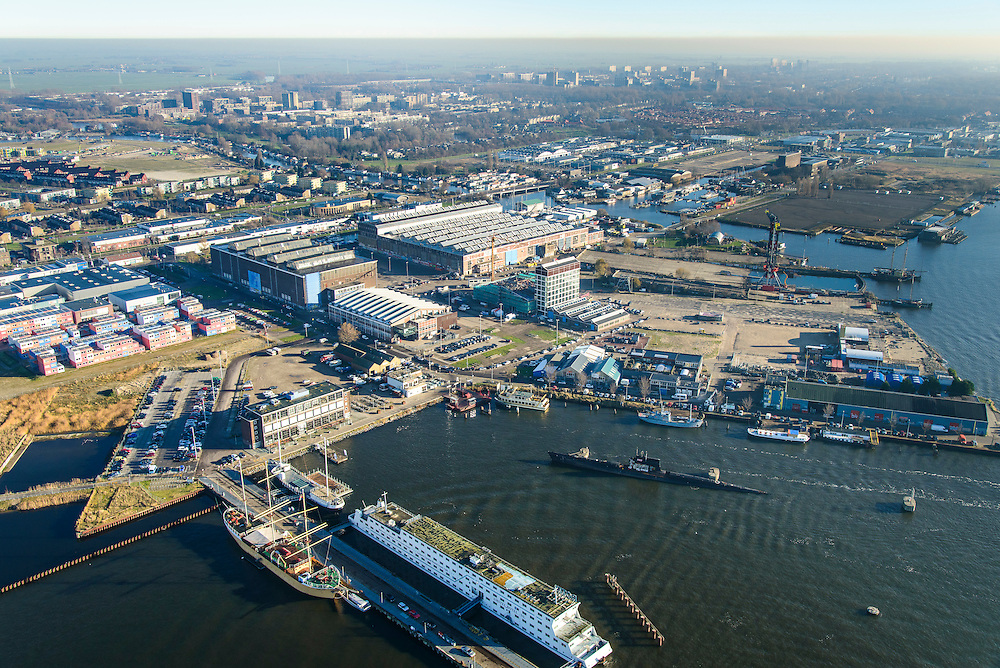 Nederland, Noord-Holland, Amsterdam, 11-12-2013; Amsterdam-Noord, Mediawharf, terrein van voormalige NDSM-werf. Onder andere MTV, IJ-kantine, containerwoningen (studentenhuisvesting).<br /> Mediawharf, hub for creative industry, former NDSM-shipyard.<br /> luchtfoto (toeslag op standaard tarieven);<br /> aerial photo (additional fee required);<br /> copyright foto/photo Siebe Swart.