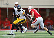 November 25, 2011: Iowa Hawkeyes wide receiver Marvin McNutt (7) tries to avoid Nebraska Cornhuskers safety Austin Cassidy (8) during the first half of the NCAA football game between the Iowa Hawkeyes and the Nebraska Cornhuskers at Memorial Stadium in Lincoln, Nebraska on Friday, November 25, 2011. Nebraska defeated Iowa 20-7.