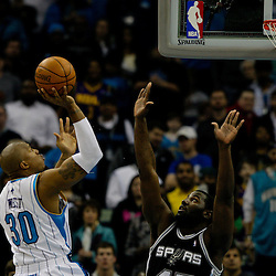 Jan 18, 2010; New Orleans, LA, USA; New Orleans Hornets forward David West (30) shoots over San Antonio Spurs forward DeJuan Blair (45) at the New Orleans Arena. The Spurs defeated the Hornets 97-90. Mandatory Credit: Derick E. Hingle-US PRESSWIRE