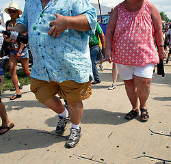 02 May 2015. New Orleans, Louisiana.<br /> The New Orleans Jazz and Heritage Festival. <br /> Heavy people in the crowd. <br /> Photo; Charlie Varley/varleypix.com