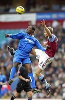 Fotball<br /> Premier League 2004/05<br /> Aston Villa v Birmingham<br /> Villa Park<br /> 12. desember 2004<br /> Foto: Digitalsport<br /> NORWAY ONLY<br /> Aston Villa's Olof Mellberg and Birmingham City's Emile Heskey leap for the high ball