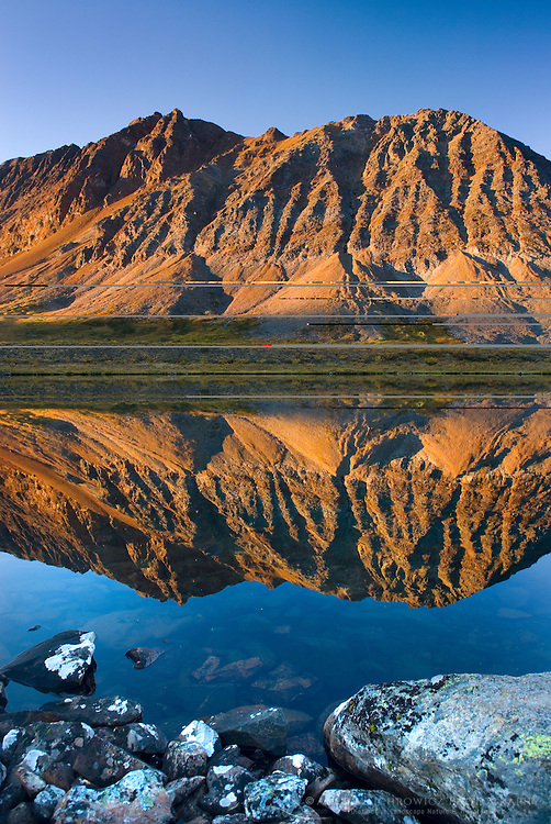 Peaks of the Tombstone Range reflected in Grizzly Lake, Tombstone territorial Park Yukon Canada
