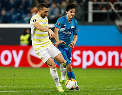 February 21, 2019 - Saint Petersburg, Russia - Sardar Azmoun (R) of FC Zenit Saint Petersburg and Mehmet Topal of Fenerbahce SK vie for the ball during the UEFA Europa League Round of 32 second leg match between FC Zenit Saint Petersburg and Fenerbahce SK on February 21, 2019 at Saint Petersburg Stadium in Saint Petersburg, Russia. (Credit Image: © Mike Kireev/NurPhoto via ZUMA Press)