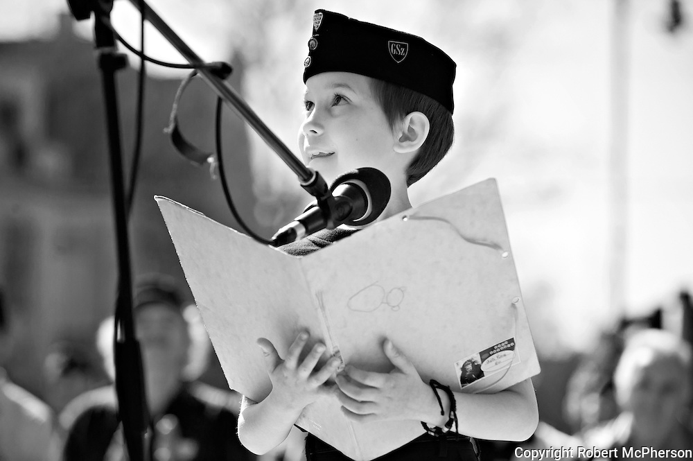 "A young boy who is a member of ""The Hungarian Guard"". By western media they are usually defined as a paramilitary organization. The Hungarian Guard have more than thousand members and is associated with the government party Jobbic. The president of ""The Hungarian Guard"" was Gábor Vona who today is the leader of the third largest party in the government called Jobbic. Jobbic is a right-wing extremist government party."