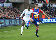 Modou Barrow of Swansea City and Martin Kelly of Crystal Palace during the Premier League match between Swansea City and Crystal Palace at the Liberty Stadium, Swansea, Wales on 26 November 2016. Photo by Andrew Lewis.