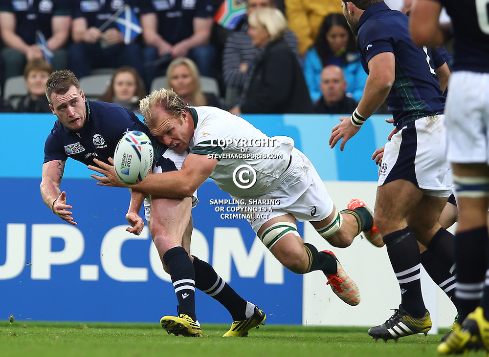 NEWCASTLE UPON TYNE, ENGLAND - OCTOBER 03: Stuart Hogg of Scotland is tackled by Schalk Burger of South Africa during the Rugby World Cup 2015 Pool B match between South Africa and Scotland at St James Park on October 03, 2015 in Newcastle upon Tyne, England. (Photo by Steve Haag/Gallo Images)