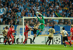 MARSEILLE, FRANCE - Tuesday, September 16, 2008: Liverpool's goalkeeper Pepe Reina and Olympique de Marseille's Lorik Cana during the opening UEFA Champions League Group D match at the Stade Velodrome. (Photo by David Rawcliffe/Propaganda)