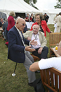 Stirling Moss and David Piper. Cartier Style et Luxe champagne reception and lunch at the  the Goodwood festival of Speed. 9 July 2006. -DO NOT ARCHIVE-© Copyright Photograph by Dafydd Jones 66 Stockwell Park Rd. London SW9 0DA Tel 020 7733 0108 www.dafjones.com