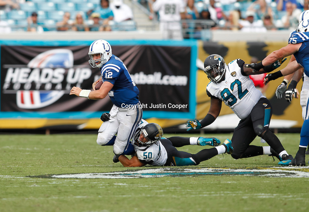 September 29, 2013:  Indianapolis Colts Quarterback Andrew Luck (12) [14978] sacked by Jacksonville Jaguars Linebacker Russell Allen (50) [11590] during the Jacksonville Jaguars 3 to 37 loss to the Indianapolis Colts at Everbank Field in Jacksonville, FL.