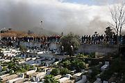 Février 2013. L'Enterrement de la révolution? Impressionnante haie d'honneur du peuple Tunisien pendant le cortège funèbre de Chokri Belaid, bravant le gaz lacrymogène, plus de 50.000 personnes lui rendent un hommage ce 8 février 2013 et manifestent au même moment contre cette violence politique, inédite en Tunisie et contre le gouvernement Ennarda.