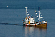 The Norwegian fishing boat MS Gulaskjær trawling fro shrimps in Hordaland, Norway.