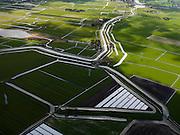 Nederland, Noord-Holland, Gemeente Schermer, 16-04-2012; in de voorgrond Polder K, onderdeel van de Schermer, droogmakerij met blokverkaveling. Op het tweede plan de Eilandspolder (laagveen gebied, vaarpolder of vaarland), met bovenaan Westgraftijk. .Lake-bed polder K (part of the polder Schermer) with square field land division..luchtfoto (toeslag), aerial photo (additional fee required);.copyright foto/photo Siebe Swart