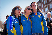 Three woman marathon runners embrace as they look over the site of deadly twin bombings, in Boston, Massachusetts, USA on 16 April 2013. At least three people died and more than a hundred were injured in an apparent terrorist attack in the northeastern US city.