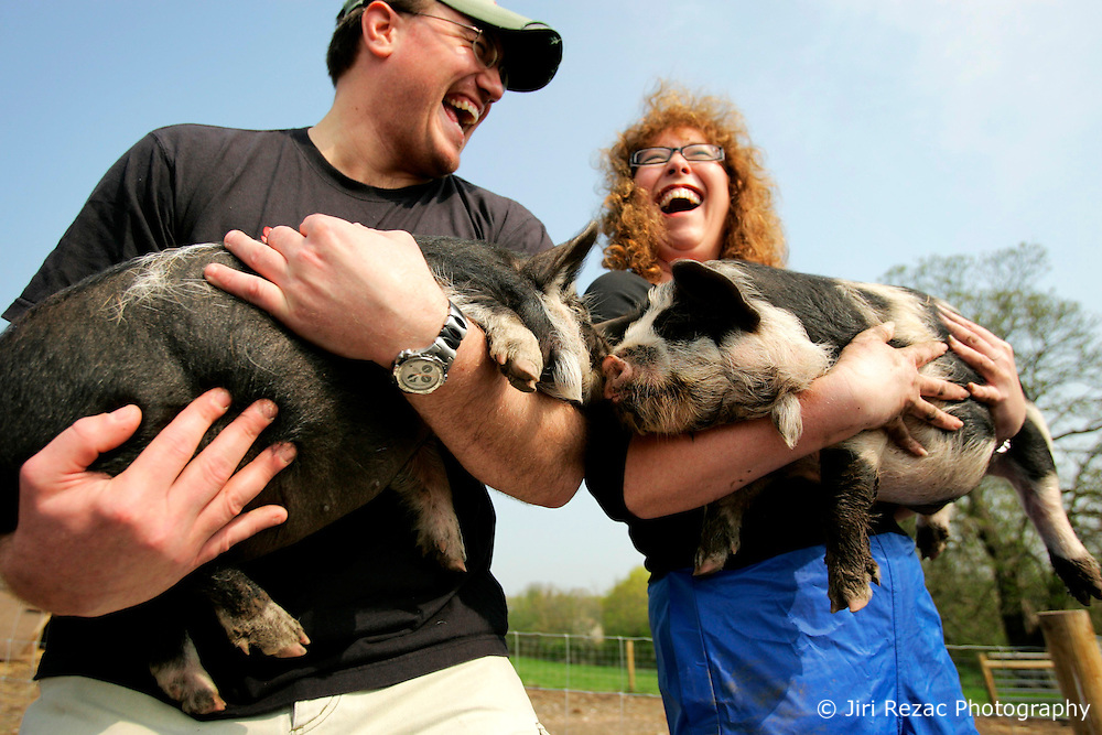 UK ENGLAND WILTSHIRE CHITTERNE 15APR07 - James Hill (33) and Jill Allen (43) hold two Kune Kune piglets at the Paradise Pig Farm run by Tony York and Carron McCann. Under the 'Pig Perfect' banner the two run a joint farm specialising in rare breeds and offer courses on pig keeping.<br /> <br /> <br />jre/Photo by Jiri Rezac<br /> <br /> <br />© Jiri Rezac 2007
