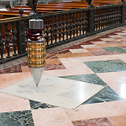 MEXICO CITY, MEXICO --A pendulum hanging in the middle of the nave of the Metropolitan Catehdral shows the slow shifting of the foundations of the church since it was built in the 16th century. Built in stages from 1573 to 1813, the Mexico City Metropolitan Cathedral is the largest Roman Catholic cathedral in the Americas. It sits in the heart of the historic quarter of Mexico City along one side of the the Zocalo.